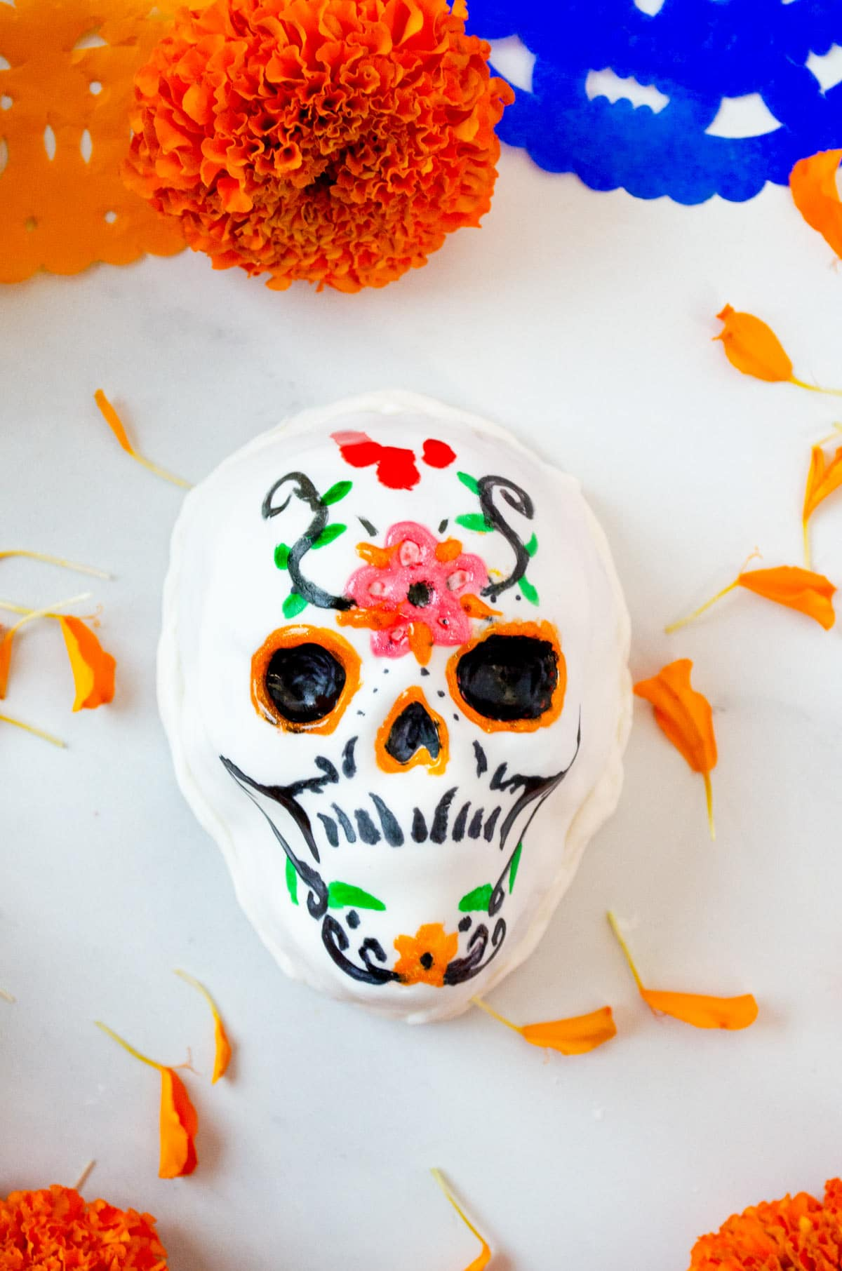 cake shaped like a skull decorated with colorful flowers