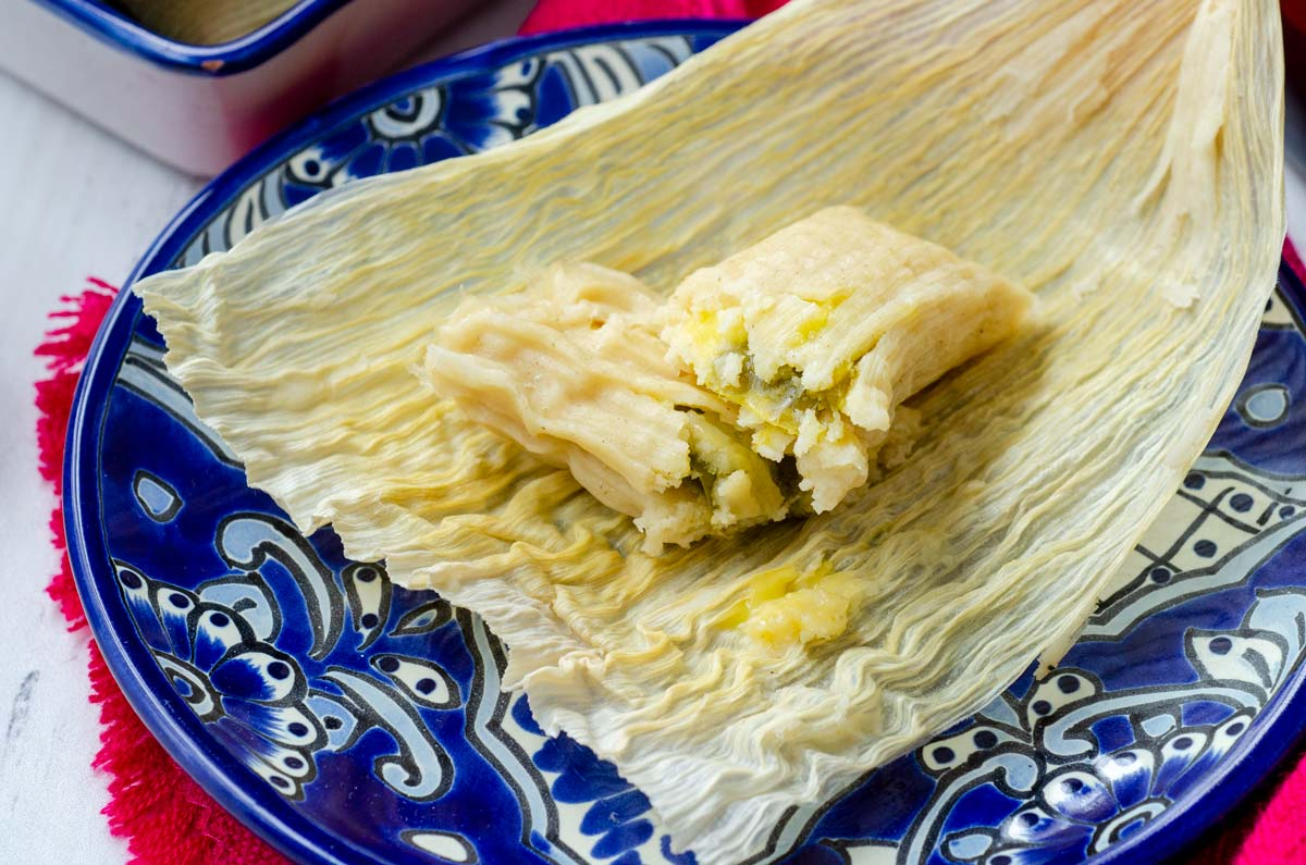jalapeño and cheese tamales on a blue plate
