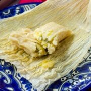cheese and jalapeño tamales on a blue plate