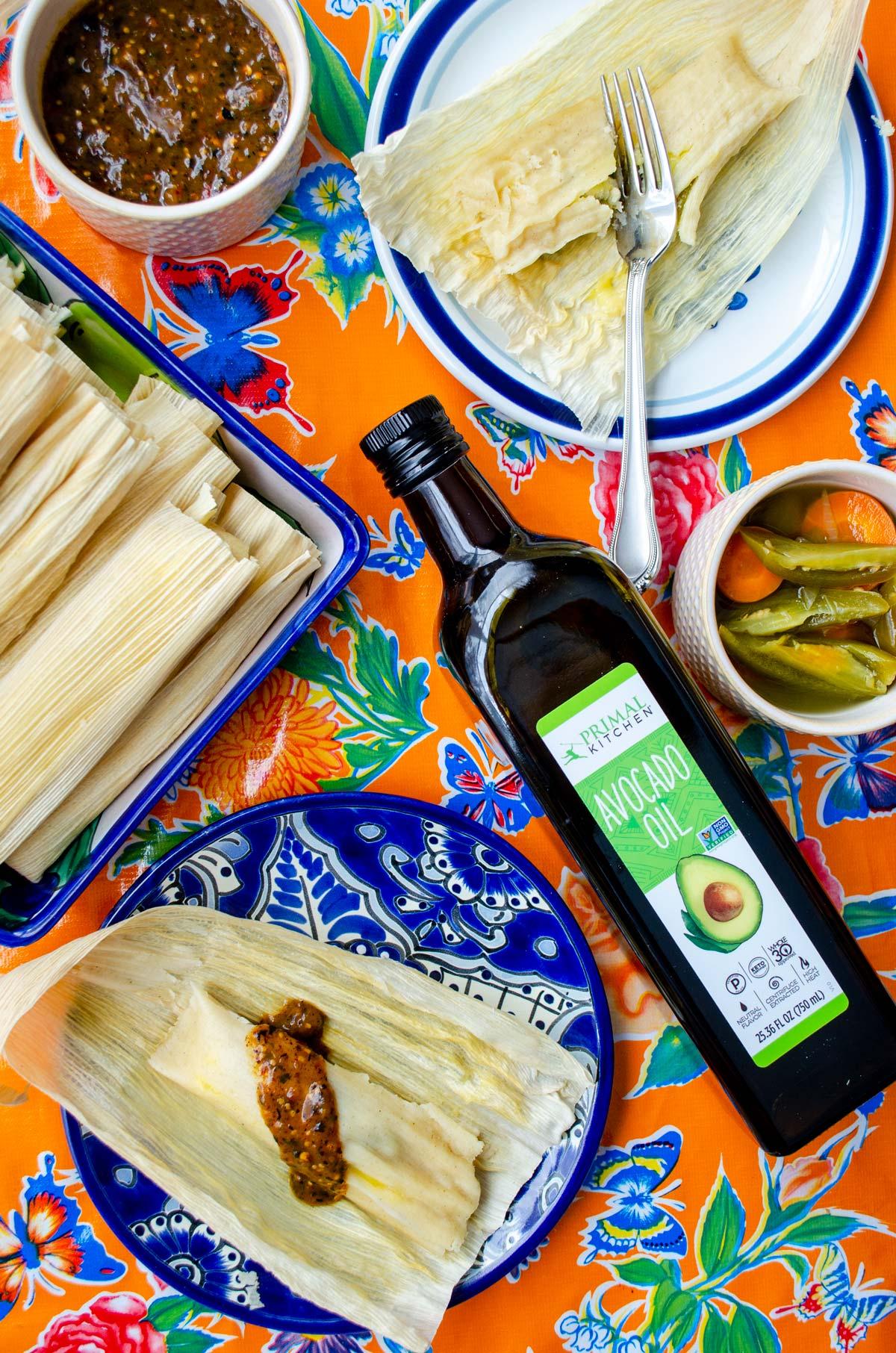 orange table cloth cheese and jalapeño tamales