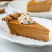 sweet potato pie topped with whipped cream