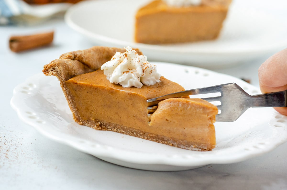 a fork cutting into sweet potato pie