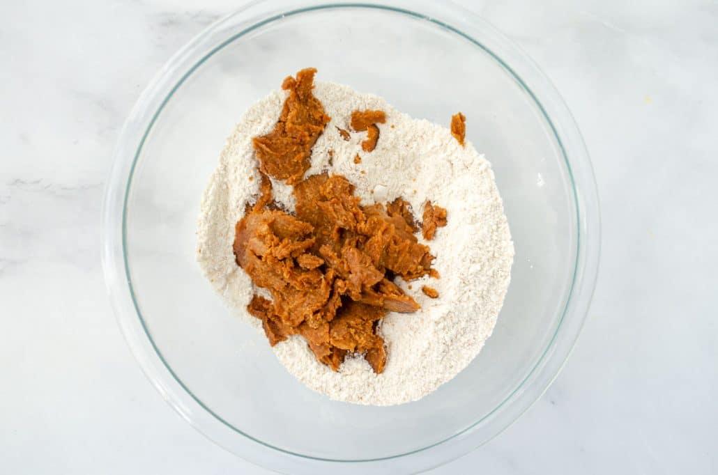 glass bowl with flour, almond butter, salt