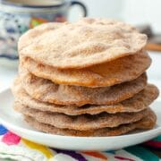stack of buñuelos on a white plate