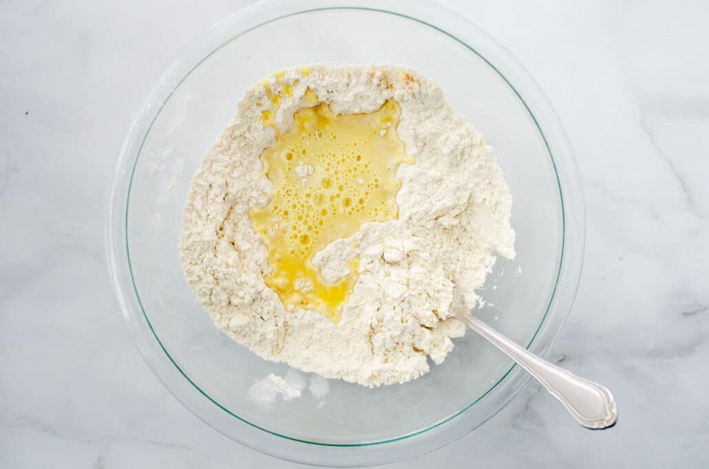 flour mixture and orange juice in glass bowl