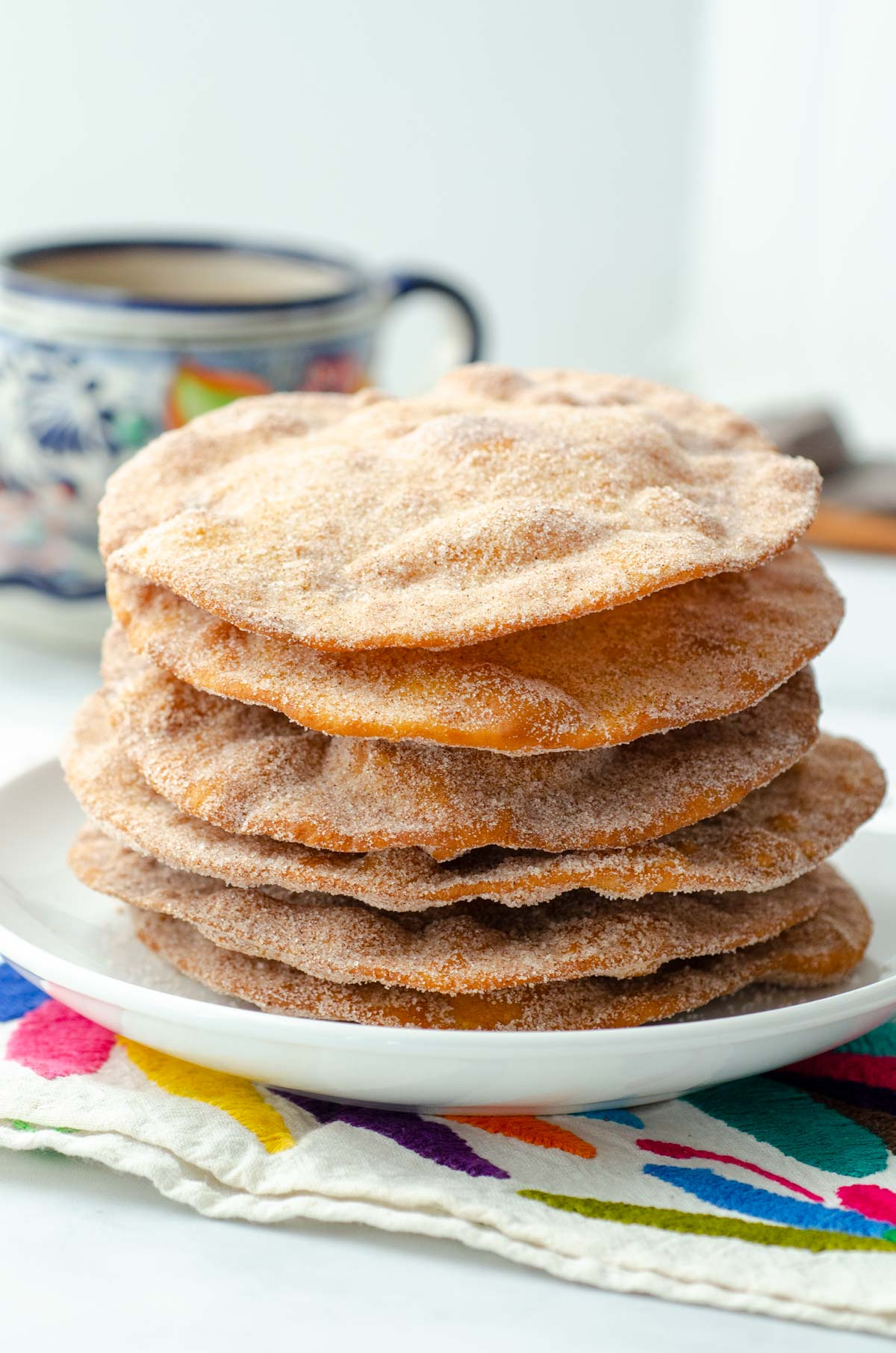 stack of Mexican buñuelos on an otomi embroidered napkin