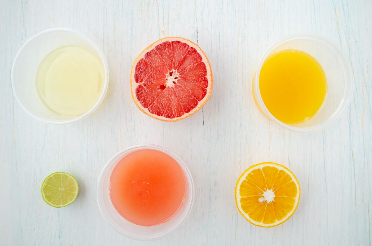 orange, lime, and grapefruit halves and juices