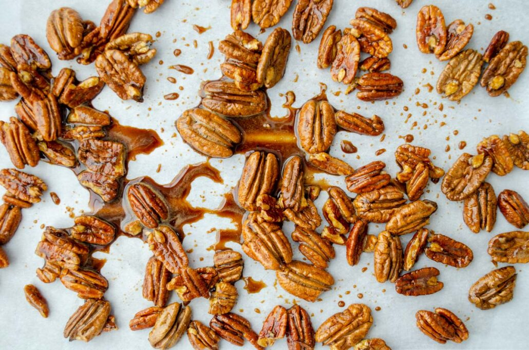 pecans in syrup on a sheet tray