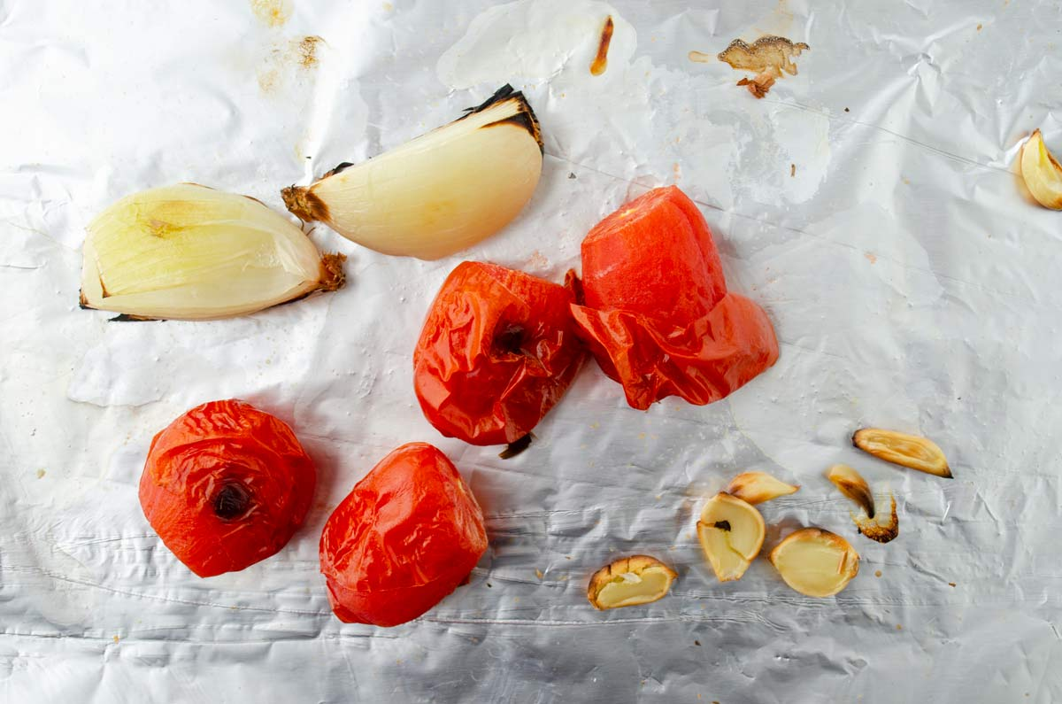 roasted tomato, onions and garlic on foil