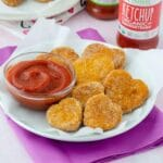 plate of tofu nuggets with a small bowl of ketchup