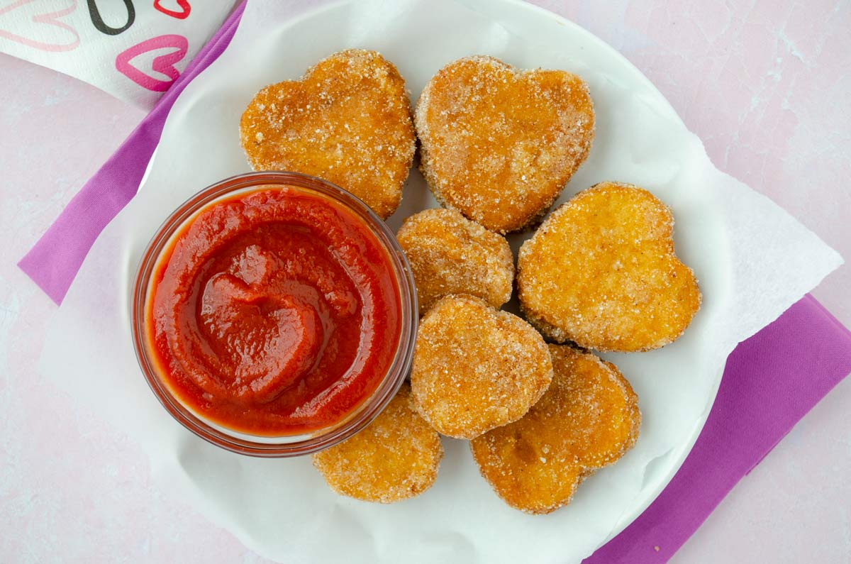 close up of nuggets and saucer of ketchup