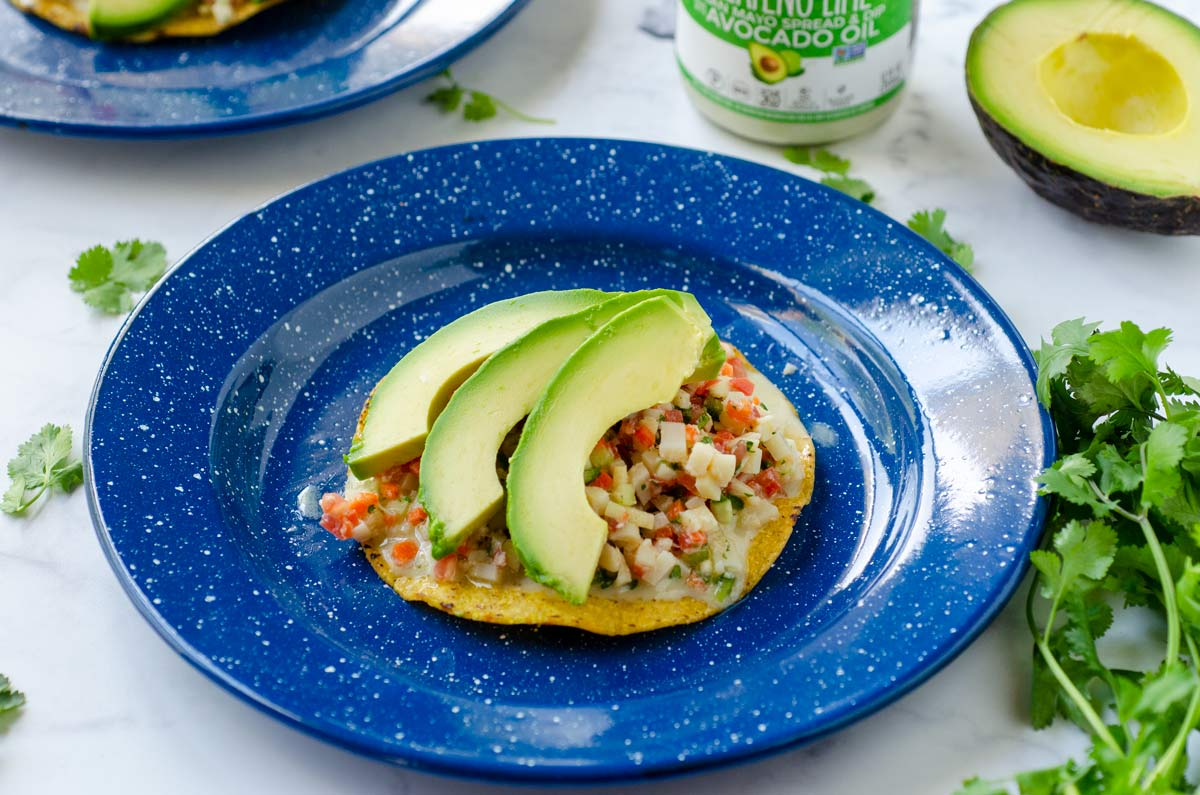 ceviche on a crisp tortilla topped with avocado