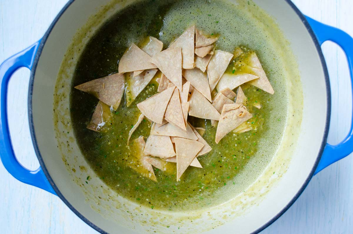 salsa verde and chips in a large enameled pot