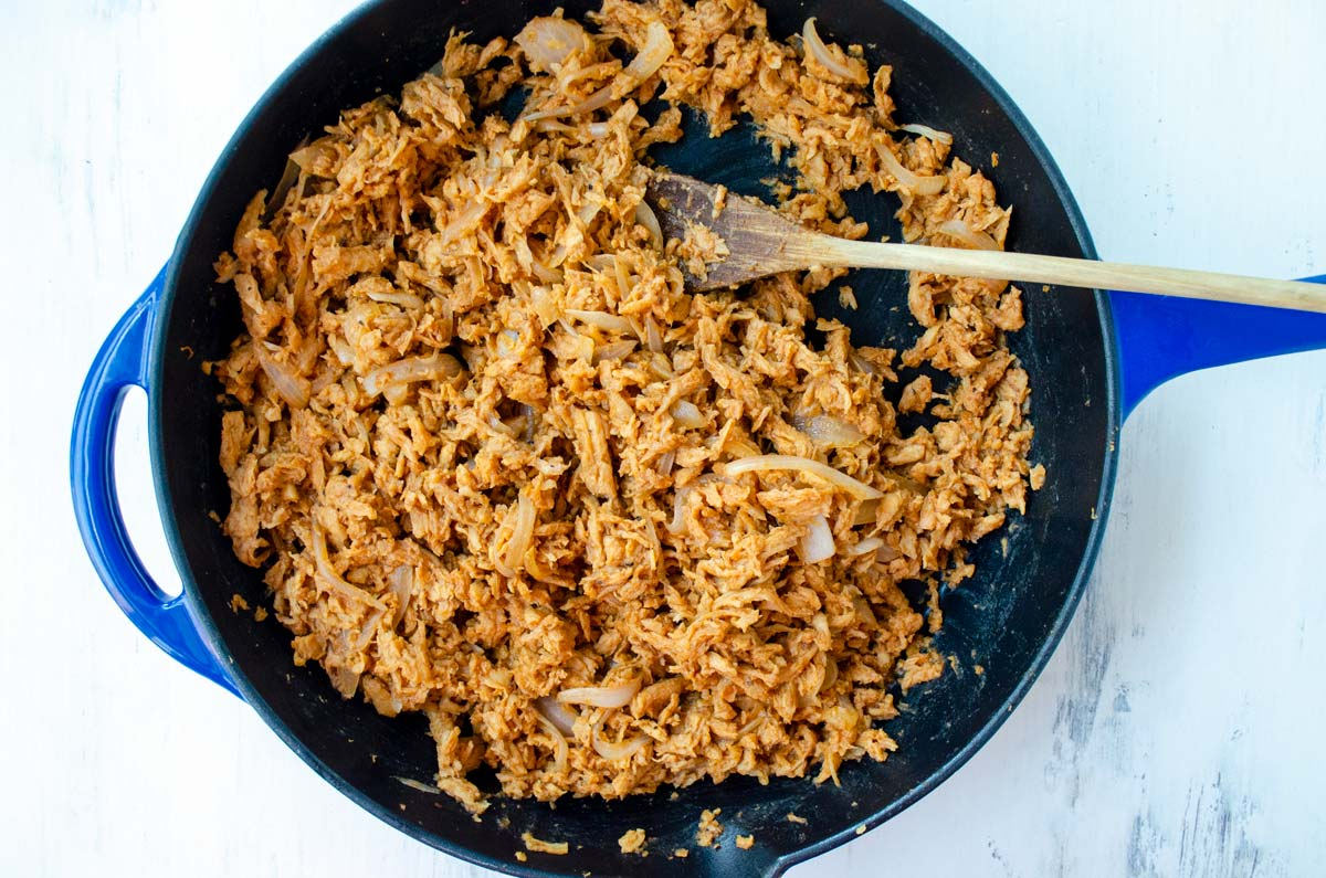 soy curls in bbq sauce on a blue and black skillet