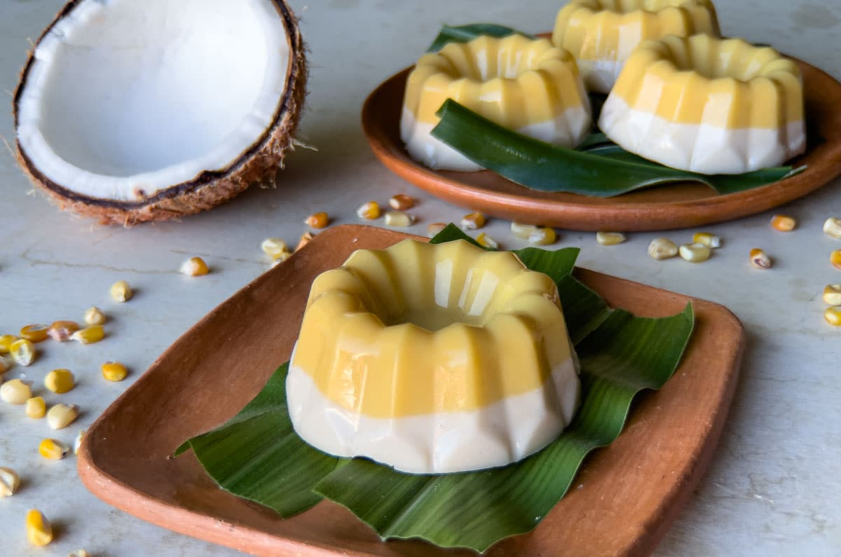passion fruit and coconut nicuatole on a banana leaf and clay plate