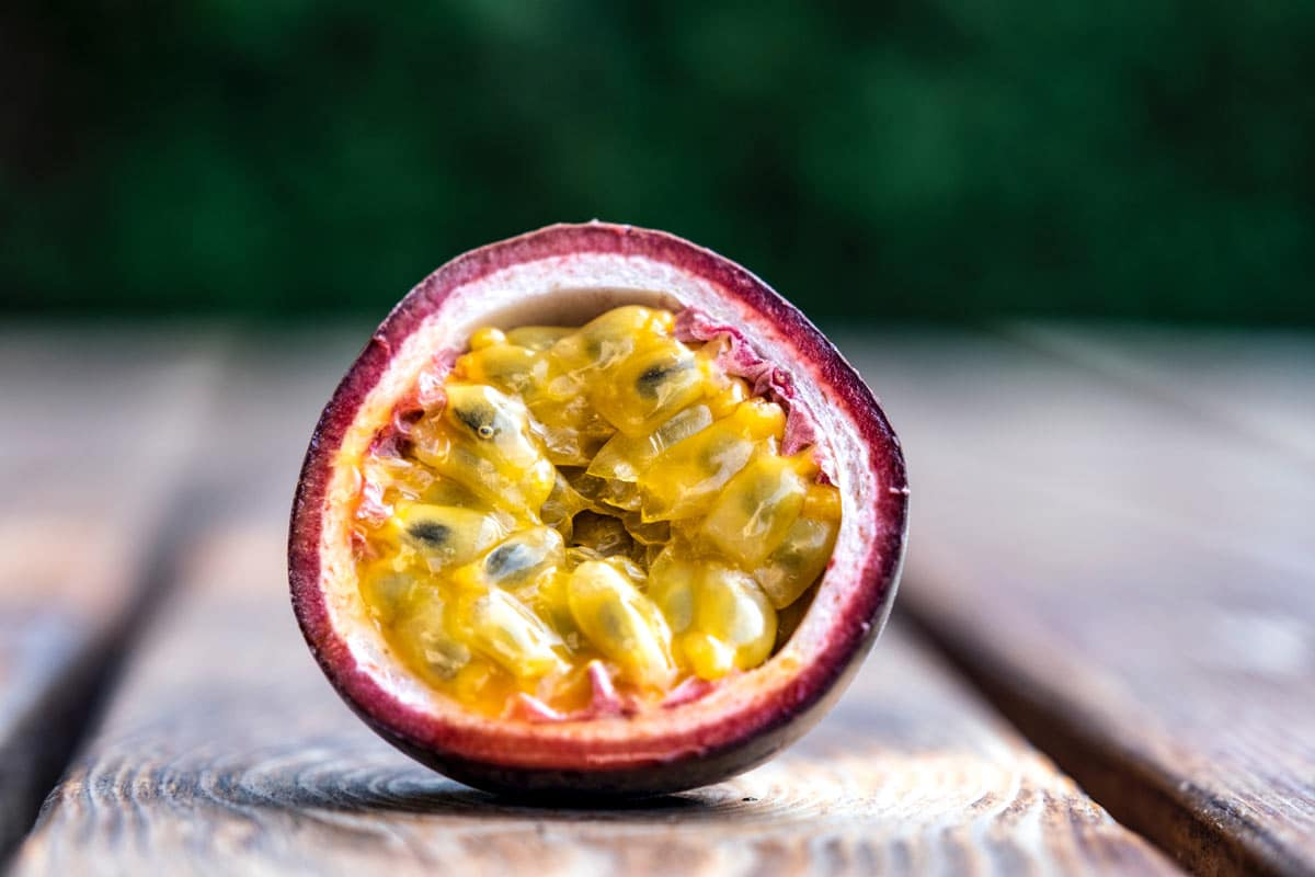 passion fruit cut in half showing seeds